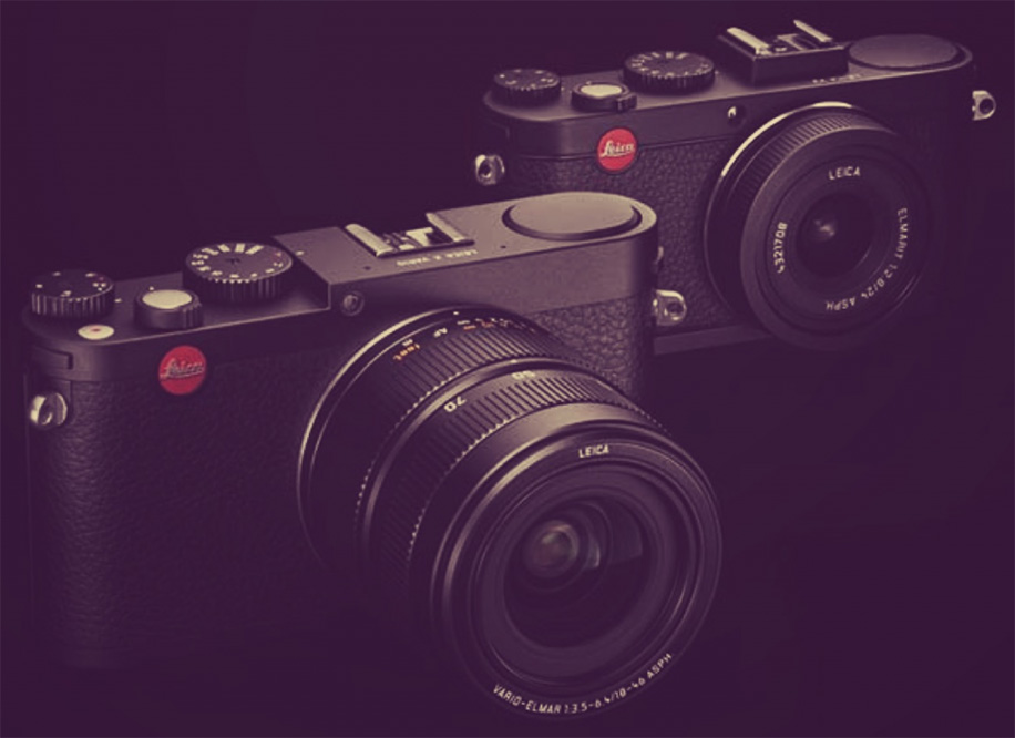 Photo: Leica Rumors. Predicted zoom-lens X (Leica X Vario?) with the current X2 in the background.