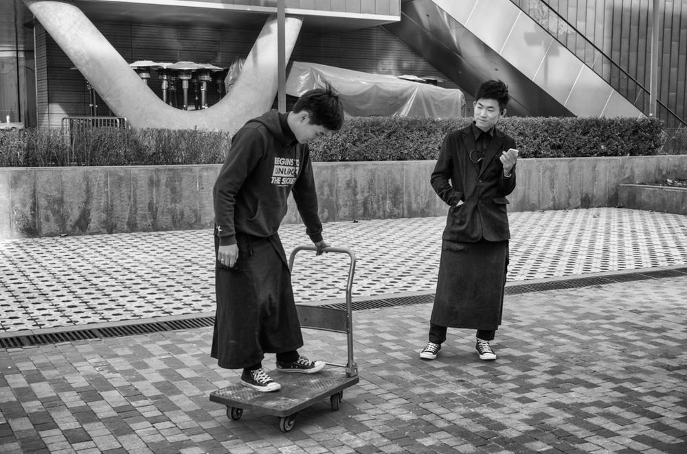 Off-duty waiters indulge in a spot of cart-boarding in Beijing