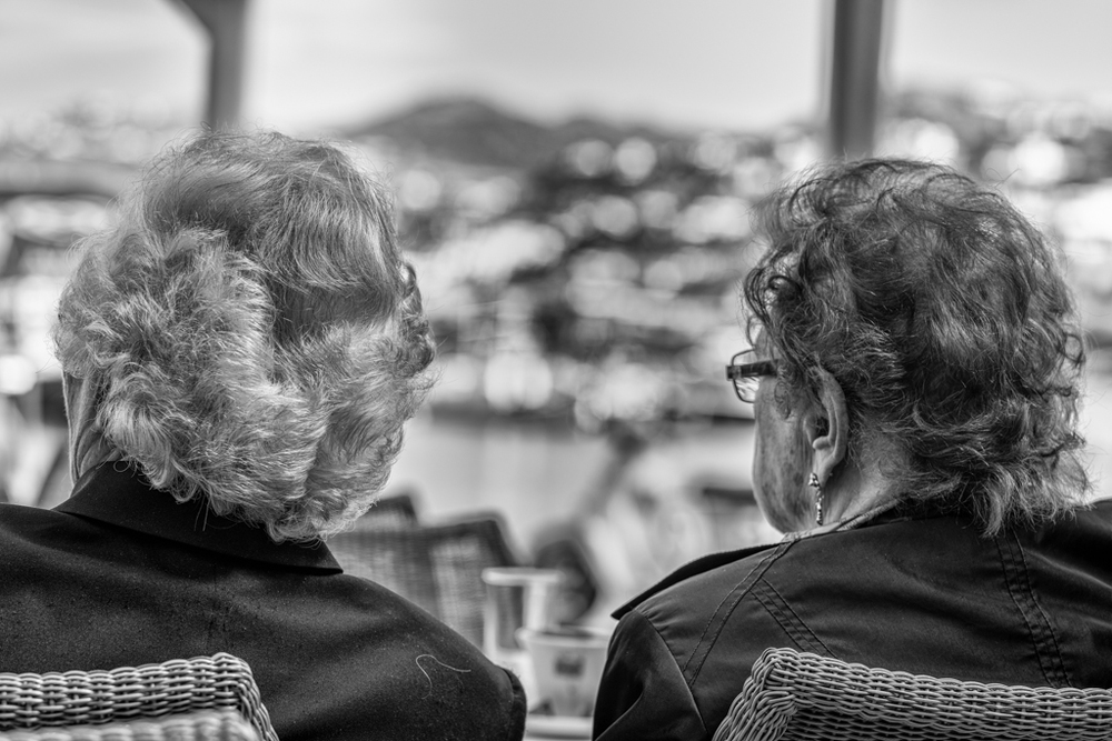 Kaffeeklatsch Greek style: Kiria Evgenia and her friend at morning coffee while surveying the old port of Mykonos. Sony A7r with 90mm Leica Apo Summicron