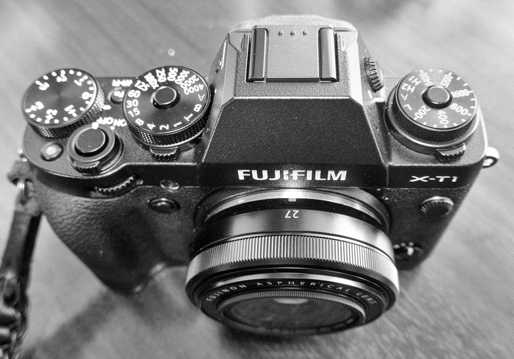 The small X-T1 with its retro DSLR looks packs a full house of manual controls and the best electronic viewfinder in the business. The Fujinon 27mm f/2.8 turns it into a superb street photography tool
