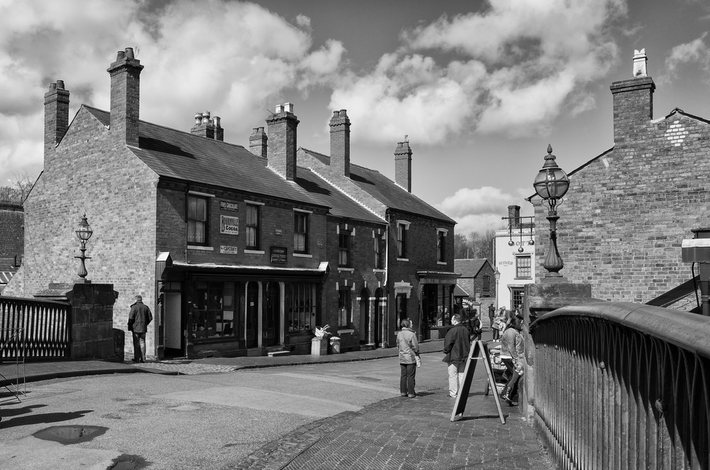 Iron canal bridge linking the two parts of the village. Walk in any shop or house and there is a volunteer in period dress anxious to do business or explain life with an outside loo (Photo Ricoh)