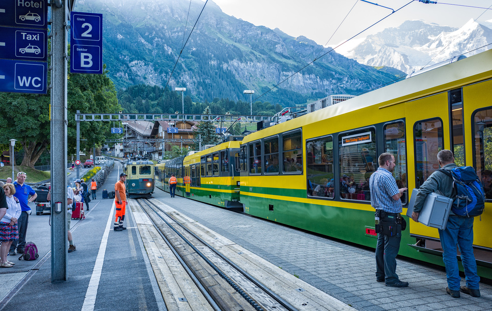 Busy Wengen station on the Wengernalpbahn at the start of the steep climb up to Kleine Scheidegg and the Eiger