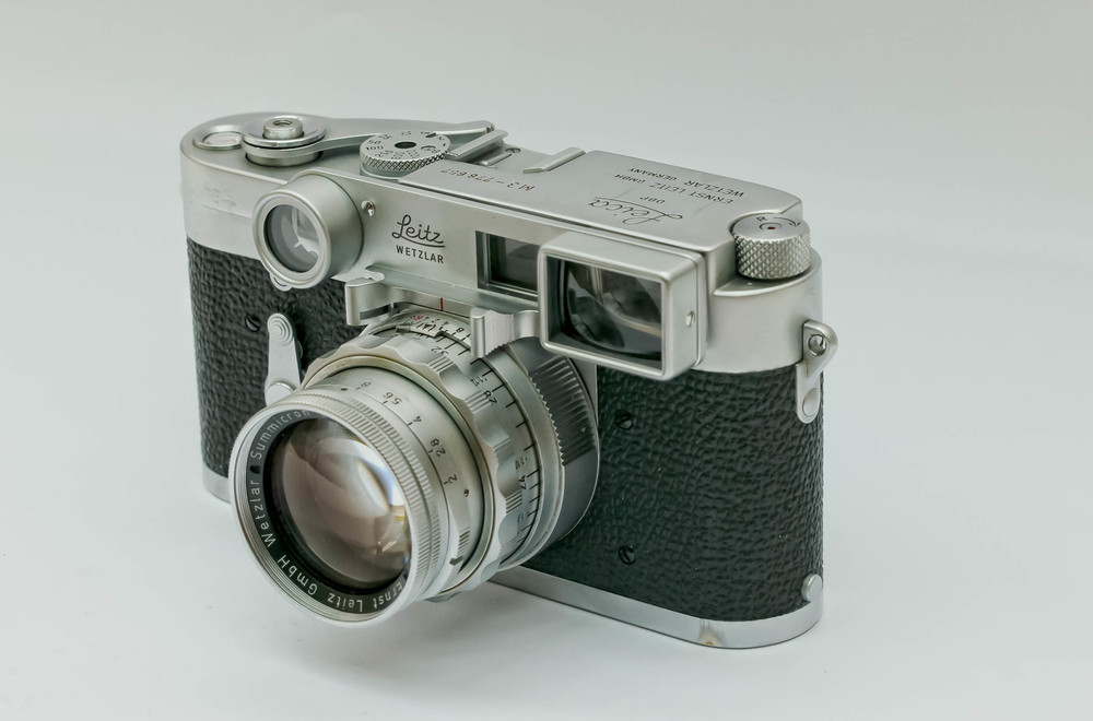 A 1955 Double Stroke M3 model with a glass pressure plate, sporting a later Dual Range 50mm f2 Summicron. The 50 DR is a true 'Heath Robinson' device (or 'Rube Goldberg' device if you are in the US) which requires an interesting series of manouevres to switch between the normal and close focus ranges. The camera came from the Westlicht Auction (with another lens) and the lens came from Tamarkin Auction in the US.
