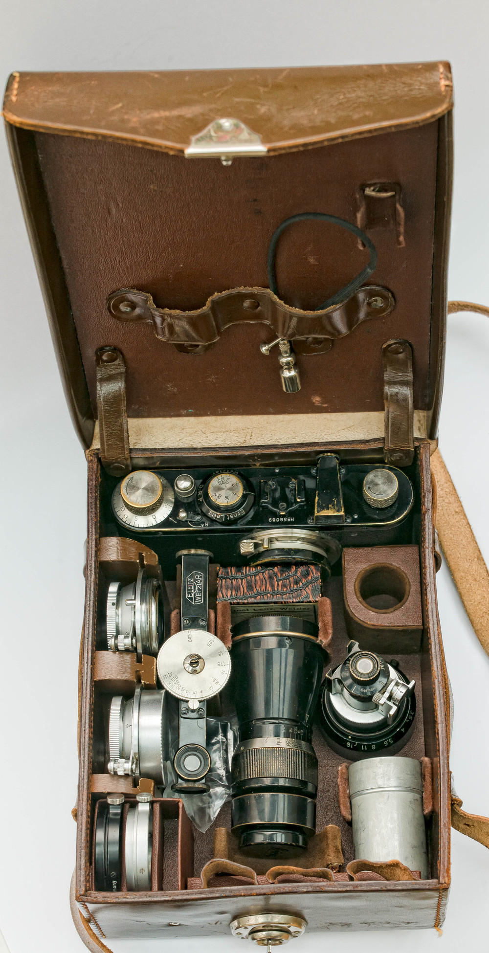 This is an ETGAM case which is the forerunner of all those modern Billinghams and LowePros stuffed with cameras and lenses. When Leica introduced the interchangeable lens on the Leica 1 Model C, they also introduced the concept of a camera outfit case at the same time and often sold them with complete outfits. This resembles a very tiny suitcase but it can be carried on its shoulder strap and it is much smaller than most of today's cases.  This one contains a 1 Model C from 1930 with a 50mm Elmar, a 10.5cm Mountain Elmar, a 2.8cm Hektor, a 3.5cm Elmar, a FOFER rangefinder, VIDOM and SUOOQ viewfinders, a VALOO hood with aperture changing feature, a spare FILCA film cassette in a metal container, an ELPIK close up lens in original box, some filters and an early cable release.  The eagle eyed will have spotted that some of these items are chrome rather than nickel but I did not get all of the items here with the case, just some of them, and I have built this outfit myself from the results of several auctions. This, of course, provides an excellent excuse to go on collecting the nickel equivalents! One final point of note about this case is that it came with its own tiny key which had accompanied the case for 85 years.