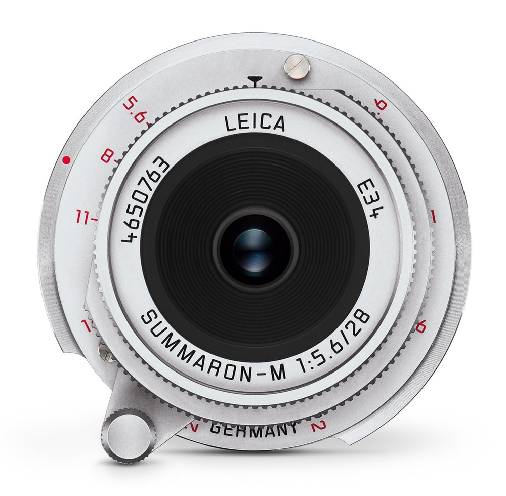 One obvious difference is that the new lens shows the serial number at the front. On the old lens it is engraved at the back and needs a magnifying glass to be found.