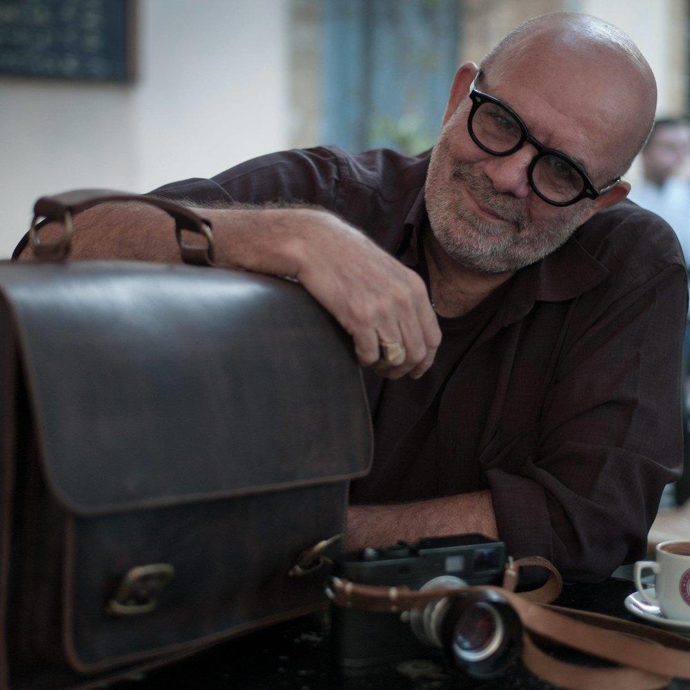 Things to come:Evris Papanikolas with his prototype leather camera bag.