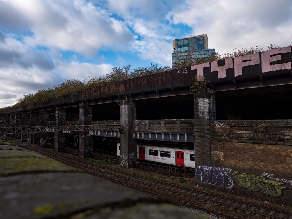 Urban decay which goes unnoticed as you sit on a smart train leaving Liverpool Street station