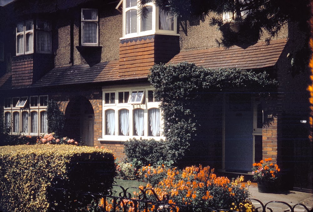 The first colour shot I ever took: My childhood home in Station Avenue, a quintessential English semi, with floral garden, in a typical London commuter suburb — Ewell in Surrey.