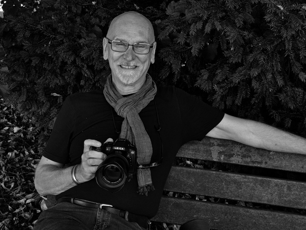 Street photographer and reader, David Lewis-Baker with his ever-ready Leica V-Lux (photo Mike Evans)