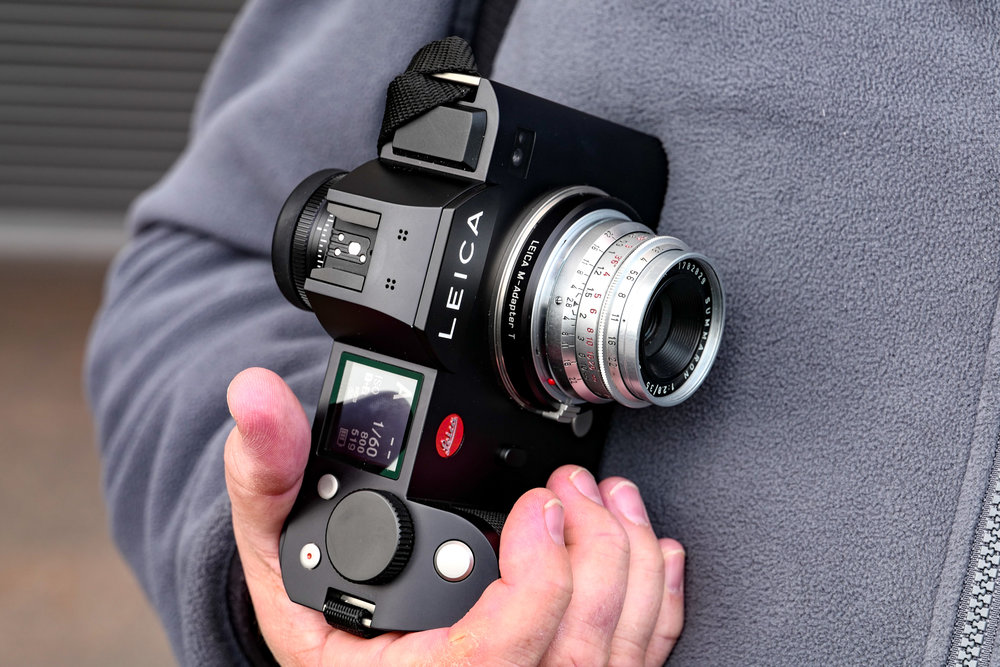 The SL works reliably with almost all M lenses — it