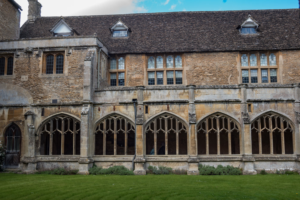 The 13th-century Lacock Abbey cloister with the William-come-lately 1540 manor house perched on top. It
