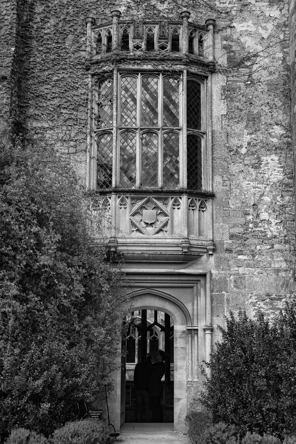 The famous oriel window seen from outside the Abbey. The cloister can be glimpsed through the archway
