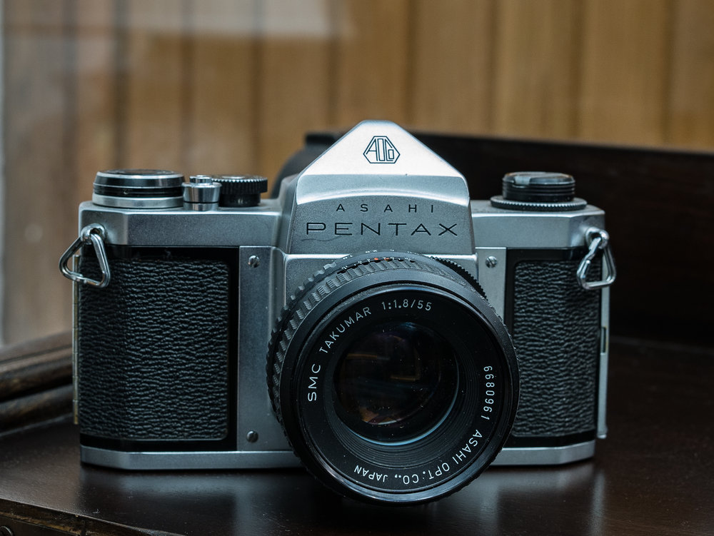 A tidy Pentax S1a including a fast f/1.8 55mm SMC Takumar lens. All for £25 at a camera fair. Even without a service, this is a good working camera. With a CLA it will be a reliable and stylish retro workhorse for any film fan for years to come. I coveted one of these camera in their heyday but never actually owned one until now (photo Panasonic GX80 and Olympus 25mm f/1.2)