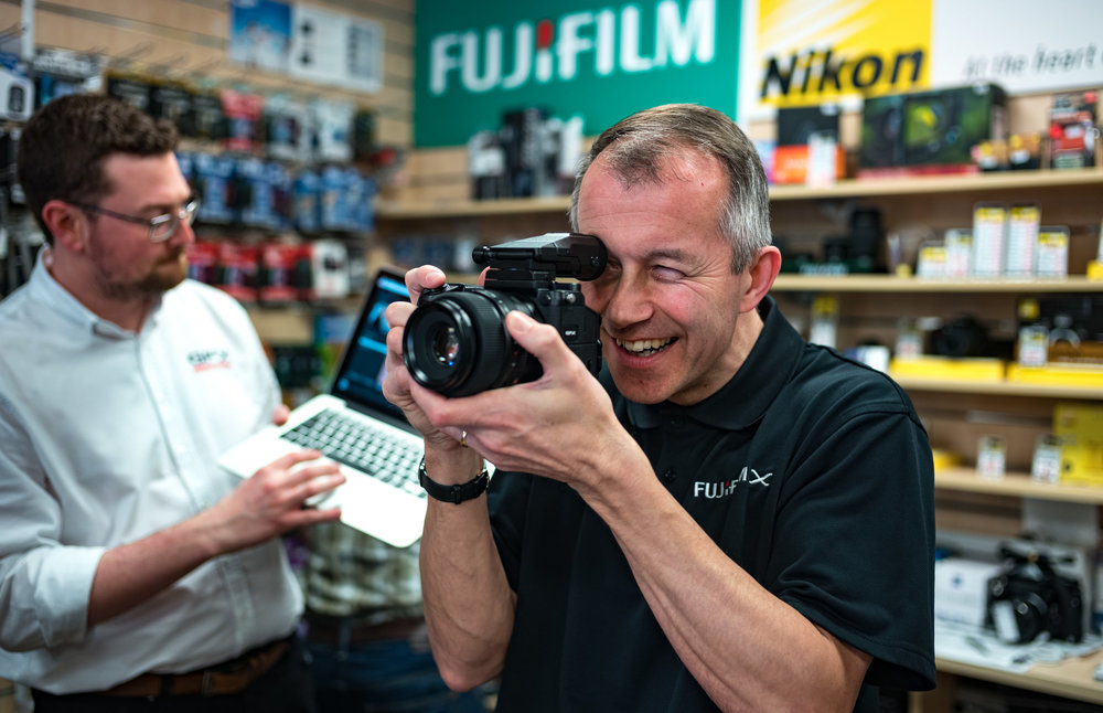 Andy Sands of  Chiswick Camera Centre  trying out the new medium format GFX, just one of the significant mirrorless competitors to the traditional DSLR (taken with the Leica M10)