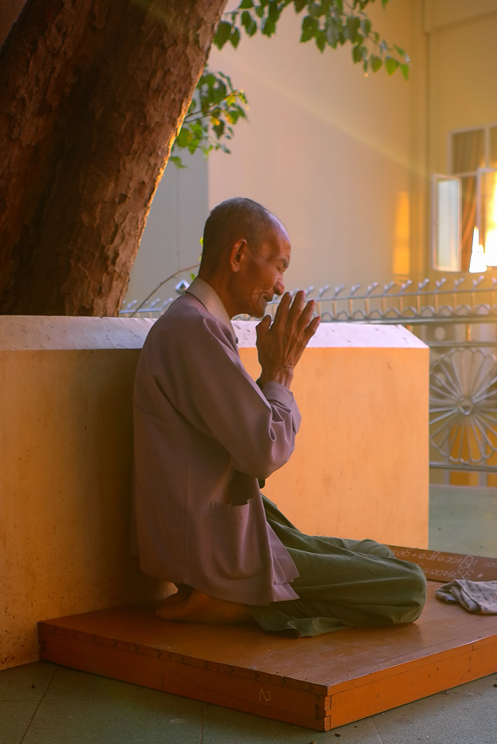 Man at prayer. Temple, Yangon Myanmar. I am very careful to be respectful when photographing people at prayer and more often than not give such shots a miss. But the angle of the light and the colours meant that I was reluctant to pass up on this one