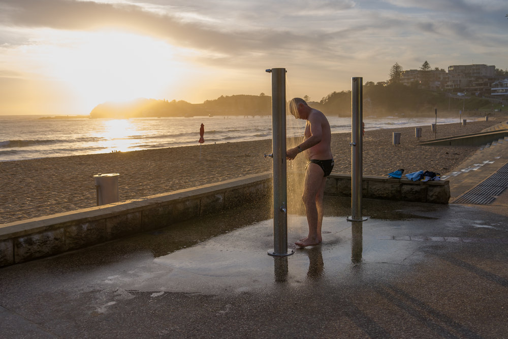Showering, Terrigal Beach. You can see this scene most mornings at Terrigal. Even in the depths of the winter there are ocean swimmers taking an early morning dip. This particular morning the light was just at the right angle