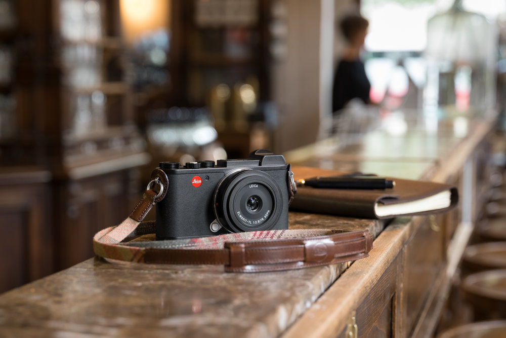The CL comes with a range of accessories, including leather and fabric straps, a thumb grip, hand grip and leather half-case with battery door.