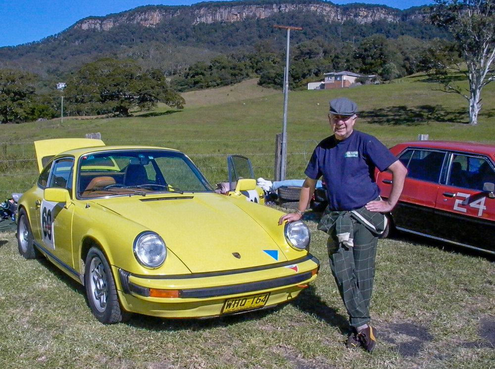 John Sr. and one of his beloved Porsches