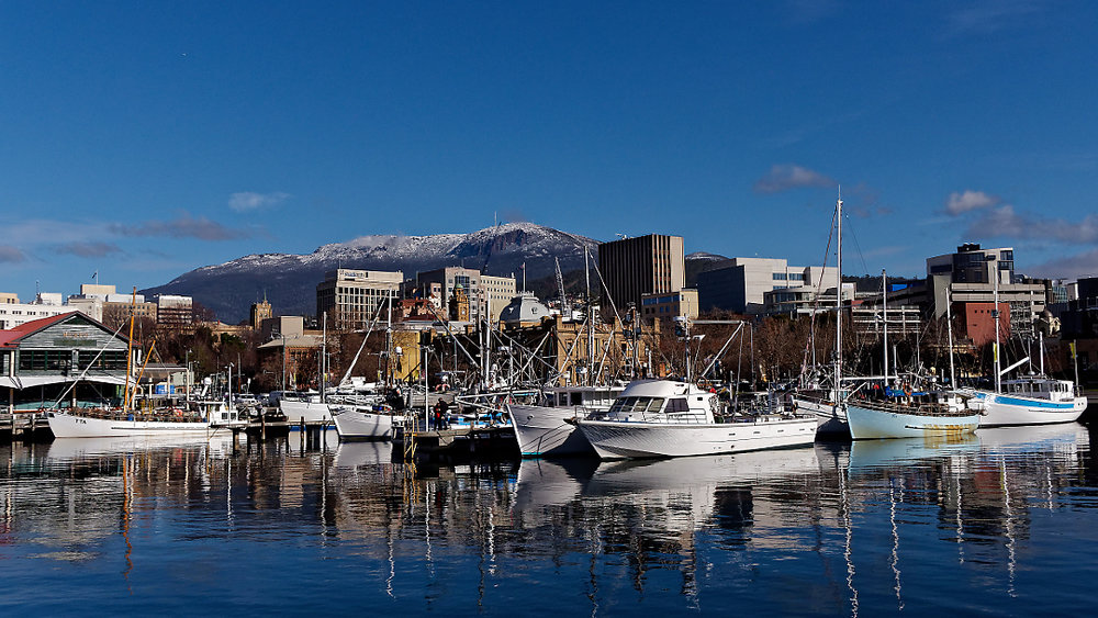 Look across Victoria Dock, Hobart. Snow-capped Mount Wellington lurks in the distance