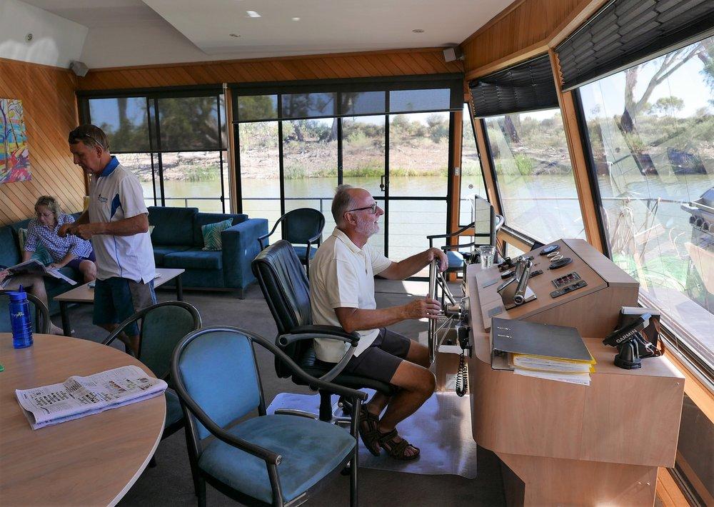 Captain Ken on the bridge of the boat