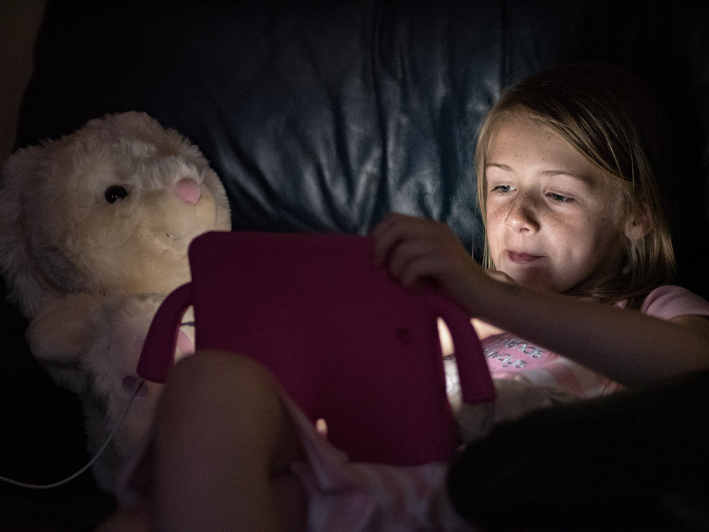 The iPad generation, taken with Panasonic GX8 and 75mm Olympus f/1.8 at ISO6400 (image Mike Evans)