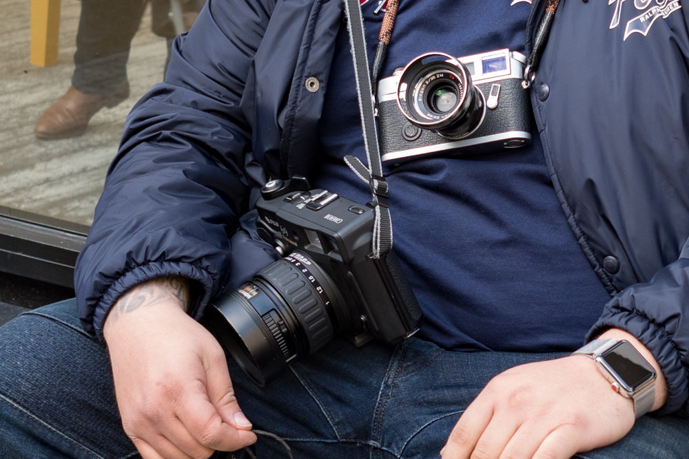 Not only does Nico carry his pristine Leica M7 with a well-used Zeiss Biogon 35mm, but for even more detail he hefts the Fuji 6x9in GW690 III. Incidentally, I approve of the Apple Watch Series 3.It provides a wonderful contrast to the old-school photography gear