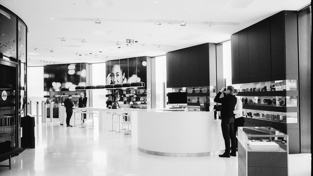 In the Leica store. Leica M6 TTL with 35mm Summilux, Kodak Tri-X 400, orange filter