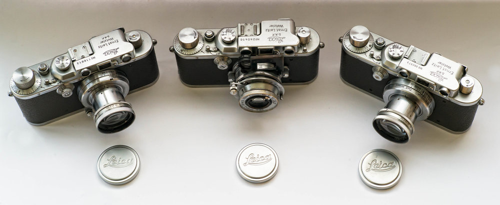A Leica IIIb, centre, which was being discontinued at the time fo the 1946 report, flanked by a pair of pre-war Leica III models. The IIIb was introduced in 1936 and there is said to have been a last batch of 600 made in 1946. The IIIc was introduced in 1940 and was changed to its post-war