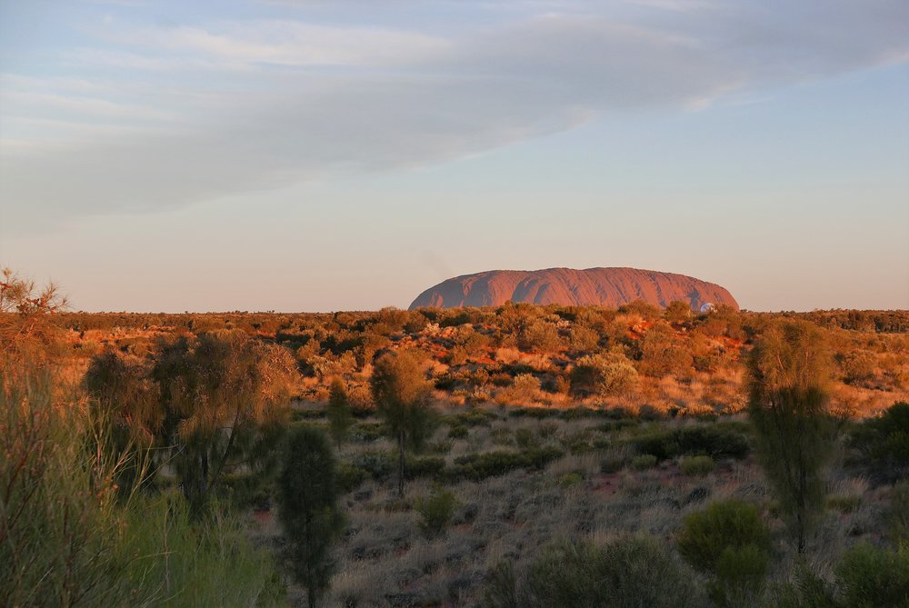 Uluru changes colour dramatically at sunset — just before....