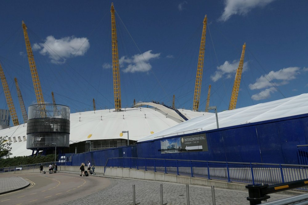 The O2 dome at Greenwich taken at 24mm. Note what appears to be a fin, centre top. Below: At 360mm all is clear — the hardy tourists, with clearly visible harnesses, making their way to the summit