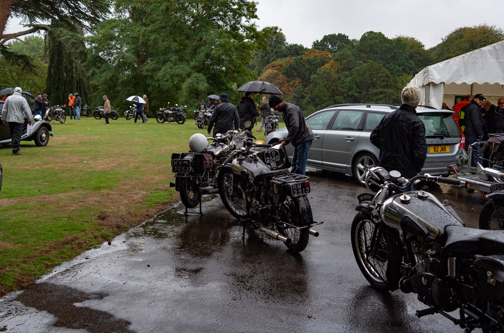 Oh dear..... Fresh from the grass car park, this was my first sight of the rally. Water, water, everywhere. All the polished metal and meticulously fettled engines battled with the downpour