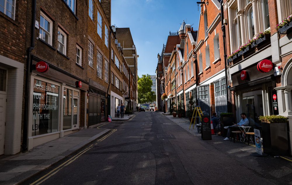 Bruton Place, looking towards the leafy Berkeley Square. On the left is the Leica Store and on the road, Leica
