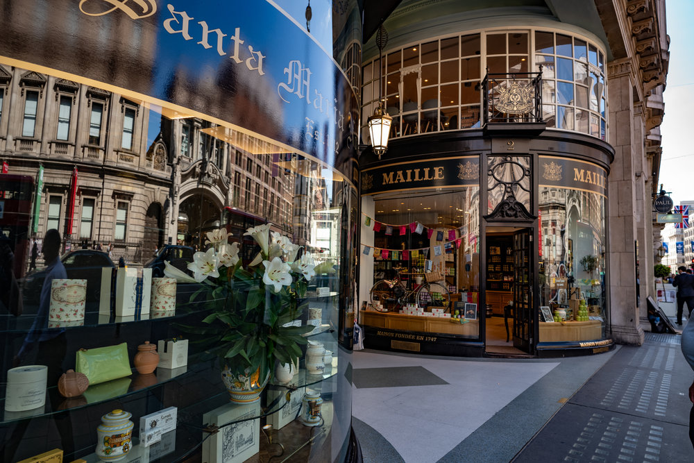 At the Piccadilly end of the  Piccadilly Arcade  which runs down to Jermyn Street, once the haunt of  Beau Brummell ,and a fine place for gentleman