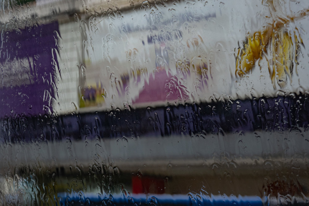 Torrent of rain in Nathan Road, through the window of the bus to Kowloon City, trundling north. A quick snap at 1/80s, f/5