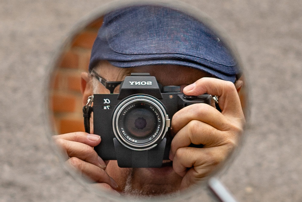 A modest photographer, with a great deal to be modest about