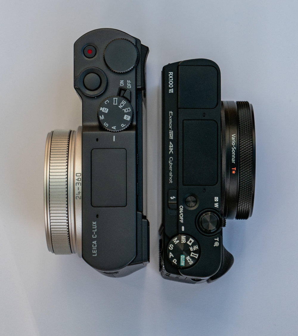 The Leica's top-plate controls are more sensible, with a proper on/off switch instead of a push-push button and a large control dial. The Sony's control dial is on the back, around the four-way pad and is much less easy to operate. The difference in the size of the lens housing is also notable, with the Leica's long zoom needing more space