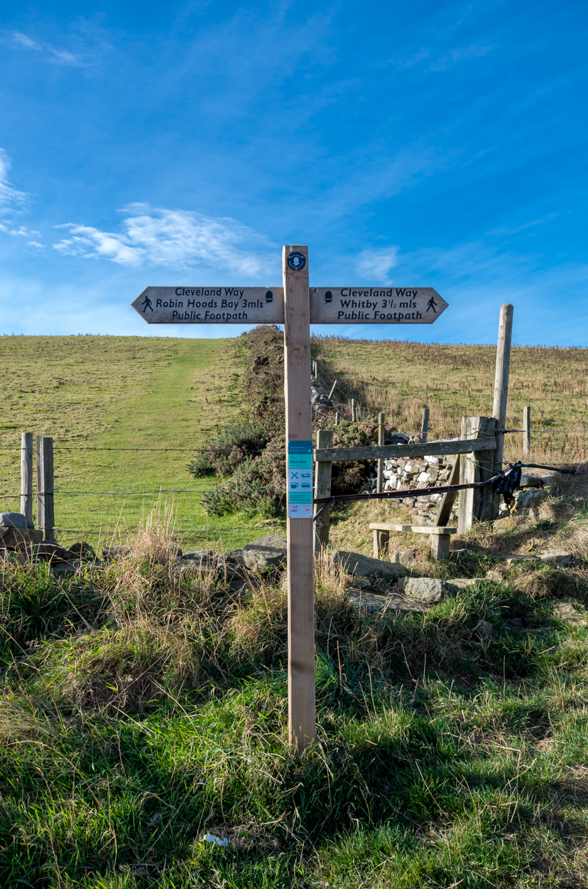 A way marker exactly halfway between Robin Hoods Bay and Whitby