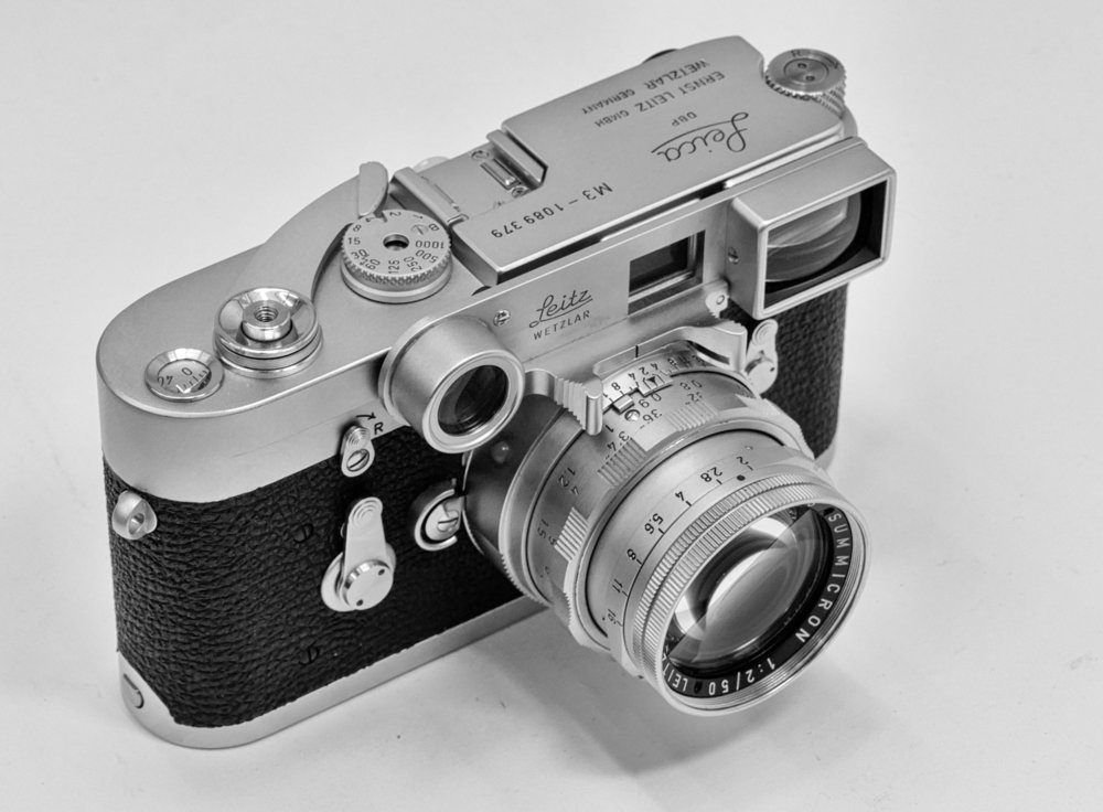 """The Leica M3, the archetypal rangefinder camera, introduced in 1953. This pristine example is fitted with the dual-range Summicron and """"specs"""".    Image Red Dot Cameras, London"""
