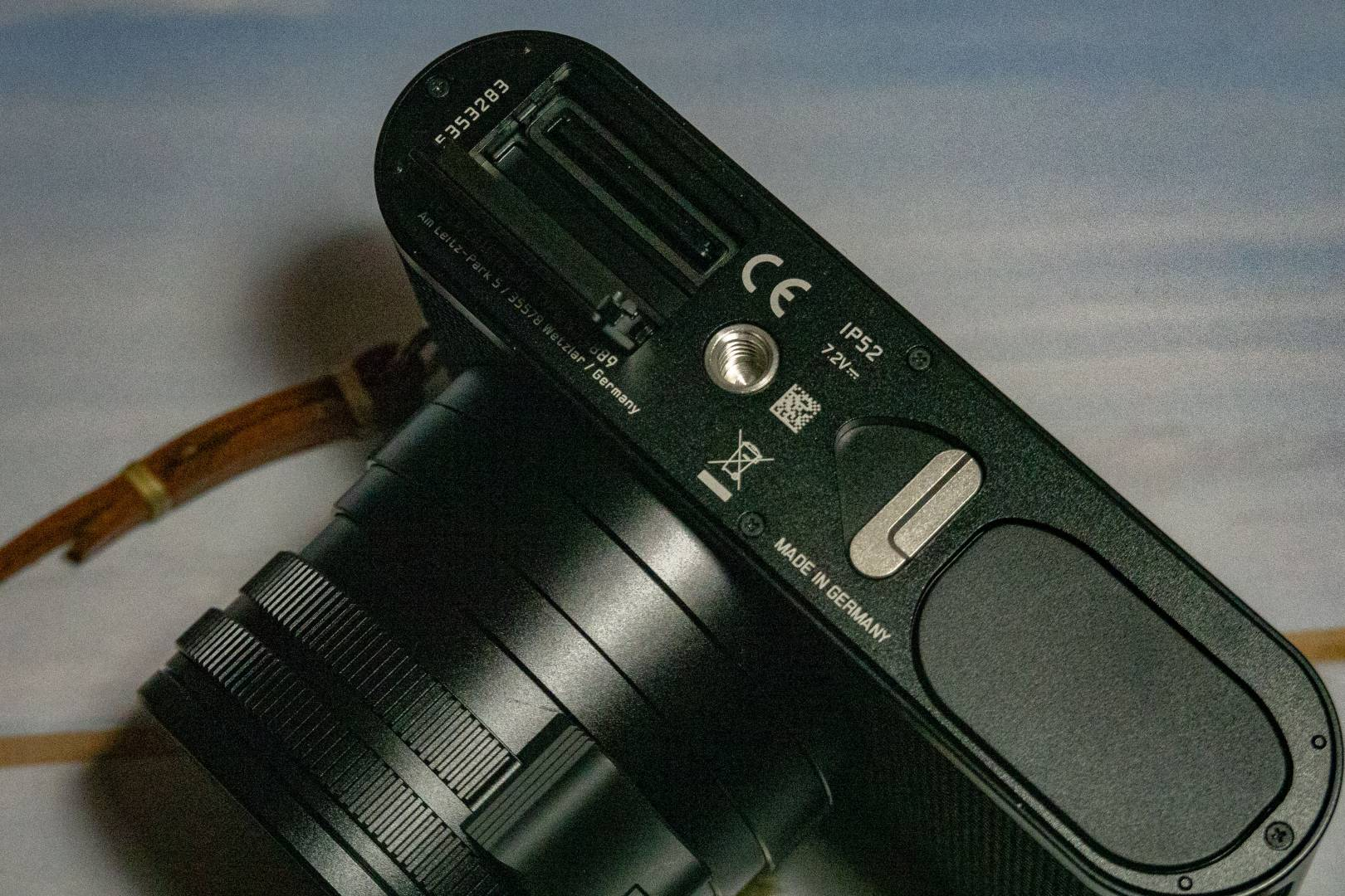 A curious layout: The SD slot sits behind a sliding door on the opposite side of the camera to the pop-out SL battery