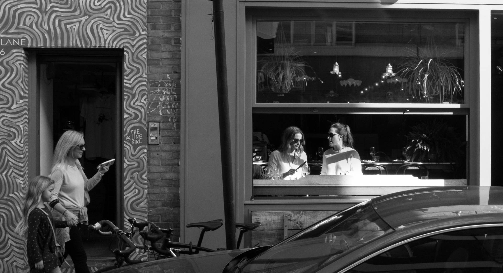 Line of girls, with art by The Line Girl. Leica X1