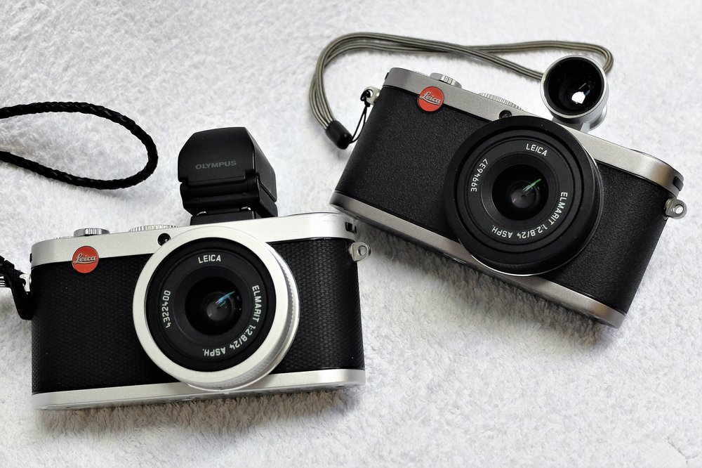 Leica X2, left, with the Olympus EVF (cheaper than Leica but exactly the same) and the X1 with optical viewfinder (Image Wayne Gerlach)