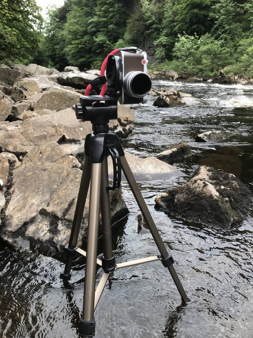 My beloved Leica X on its tripod, wading in the river. With Hoya Pro ND10 filter attached. Shot on iPhone 7 Plus