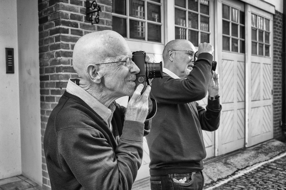 2013 and editor Mike (right) tries out the Leica Monochrom with his old friend George James outside Leica Mayfair