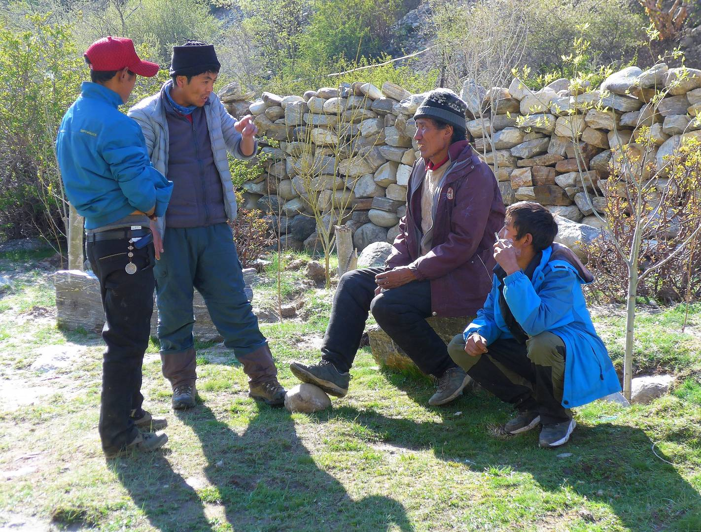 Tashi, our Chinese Tibetan guide, explained plans at a group meeting with the yakmen