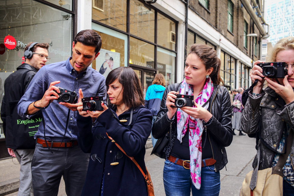 Leica M240 cameras on demonstration at a Leica pop-up store in London's Brick Lane in November, 2014. Leica Ambassador Robin Sinha on the left.