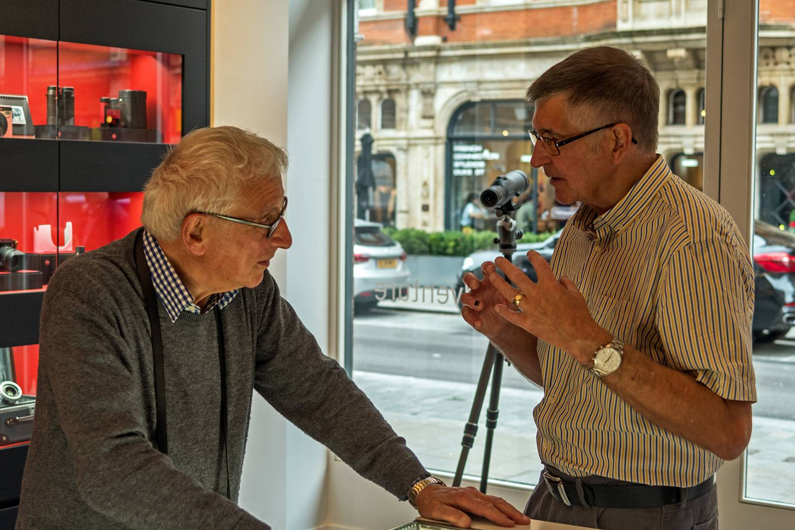 John Dudkins LRPS, wearing his Leica watch, charring with Chris Angeloglou, the former Sunday Times picture editor