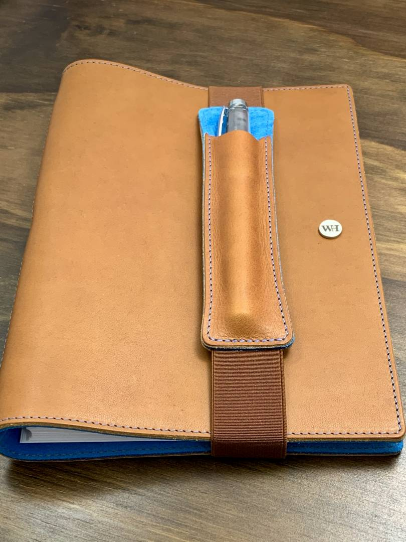 I also own this A5 notebook in whisky with kingfisher-blue interior plush lining. Again, the new pen holder keeps this organised and today