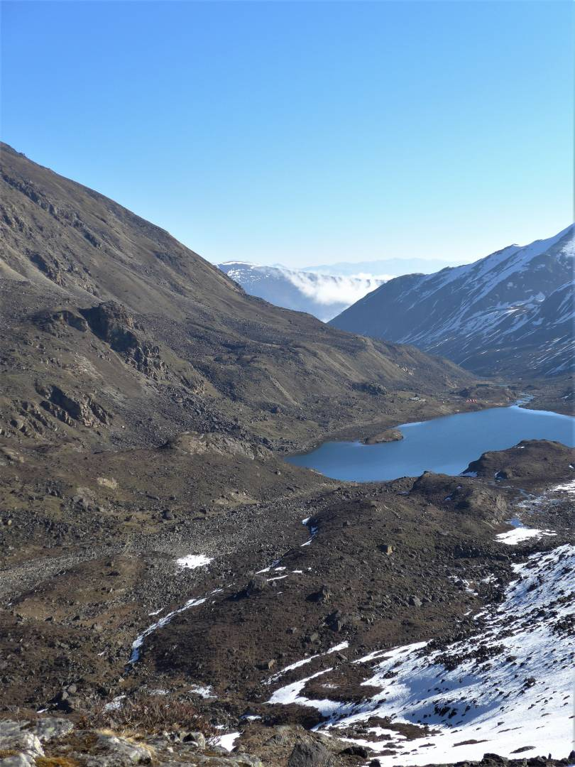 Looking back down to our campsite from the top of the pass. Our tents are the tiny orange dots at the far end of the lake - you might have to squint to see them