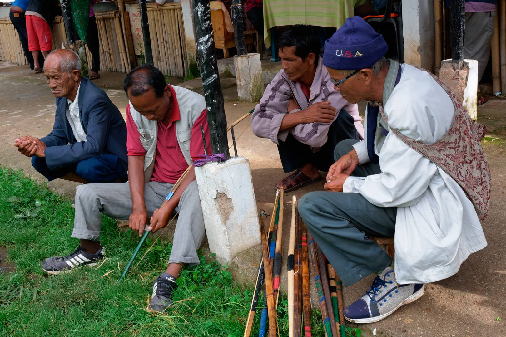 An archer trims his bow before the start of the contest. Clubs compete against each other every day in an empty lot near the Polo Grounds in the capital, Shillong