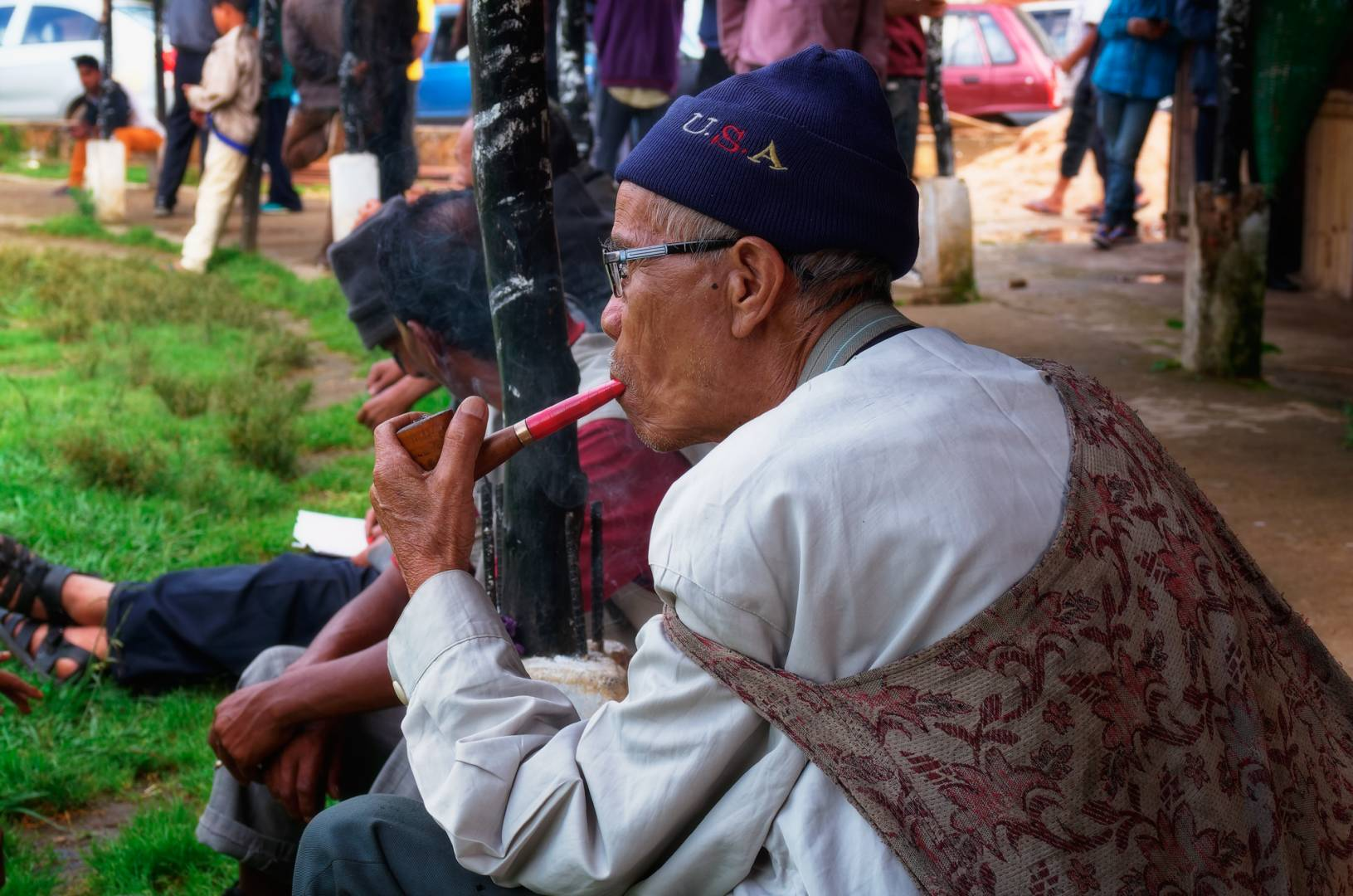 An archer smokes his pipe. The contests are held twice a day at 3.30 pm and 4.30 pm. Each archer is paid 300 rupees